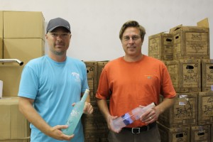 Jeremiah Butler (left) and his business partner Chris Richeson display their local vodkas, Beach Vodka and Blue Ridge Vodka.