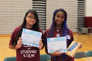 Marissa Harris (left) and Aaronique Lee (right) took second and first place respectively creating and flying their own drones through an obstacle course.