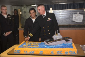 151013-N-XJ788-044 ATLANTIC OCEAN (Oct. 13, 2015) Lt. Cmdr. Chad Johnson and Seaman Recruit Joshue Bucio, representing the youngest and the oldest Sailors aboard the amphibious assault ship USS Kearsarge (LHD 3), cut a cake in celebration of the Navy's 240th birthday. Kearsarge is deployed to the U.S. 6th Fleet area of operations as part of the Kearsarge Amphibious Ready Group in support of maritime security operations. (U.S. Navy photo by Mass Communication Specialist 2nd Class Travis DiPerna/Released)