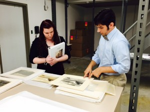 Stephanie Deach, left, Virginian Wesleyan College Public History Intern and Alex Mann, Brock Curator of American Art, review photos for the Harry Cowles Mann exhibition. Photo by Kathleen B. Casey